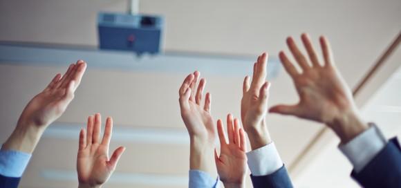 Hands of colleagues